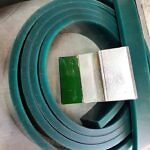 Squeegee rubber in a coil, with a small squeegee
